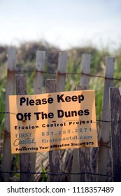 MONTAUK-NEW YORK-JUNE 8: First Coastal erosion control project sign to keep off dunes is seen on beach in Montauk, New York on June 8, 2018.