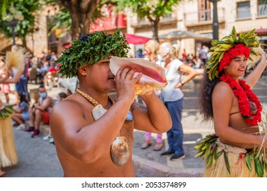 MONTBLANC - SPAIN - SEPTEMBER 12th 2021: Portrait of attractive young Polynesian Island Tahitian male dancers in colorful costumes