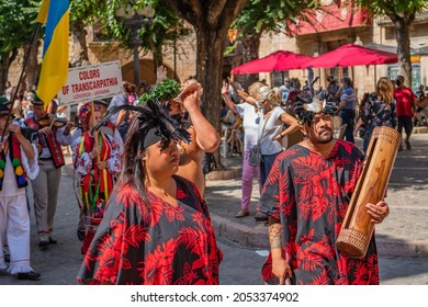 MONTBLANC - SPAIN - SEPTEMBER 12th 2021: Portrait of attractive young Polynesian Pacific Island Tahitian dancers in colorful costumes