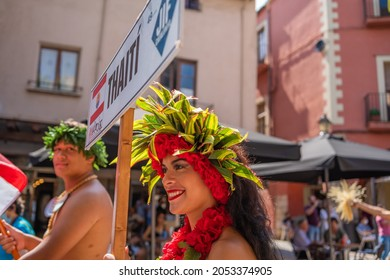 MONTBLANC - SPAIN - SEPTEMBER 12th 2021: Portrait of attractive young Polynesian Pacific Island Tahitian male and female dancers in colorful costumes