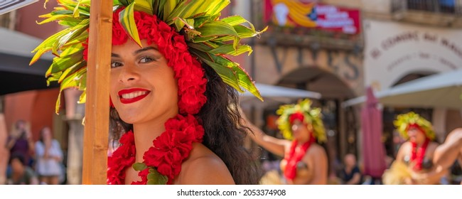 MONTBLANC - SPAIN - SEPTEMBER 12th 2021: Portrait of attractive young Polynesian Pacific Island Tahitian female dancers in colorful costumes