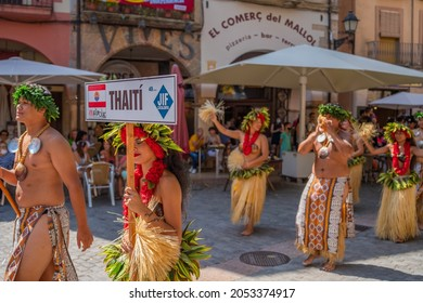 MONTBLANC - SPAIN - SEPTEMBER 12th 2021: Portrait of attractive young Polynesian Island Tahitian male and female dancers in colorful costumes