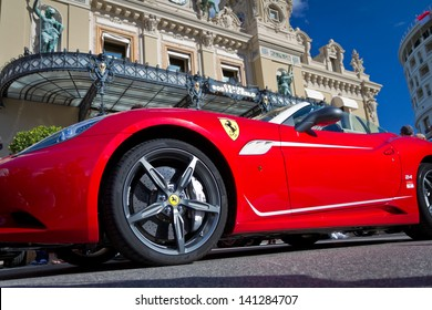 MONTE CARLO - MAY 24: Ferrari parked in front of casino on May 24, 2013 in Monte Carlo. Monaco's climate and gambling facilities have made it recreation center especially for rich and famous.