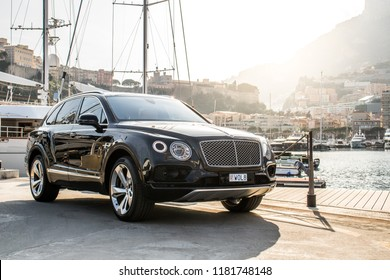 Monte Carlo, Monaco 17 September 2018 Bentley Bentayga  luxury crossover SUV stands on sunset at Monaco port background