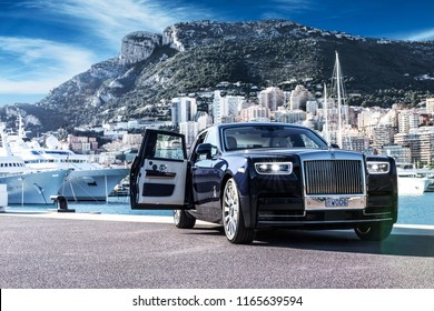 Monte - Carlo, Monaco 26 August 2018 Rolls - Royce Phantom VIII 8, in port with city and Yachts at background.