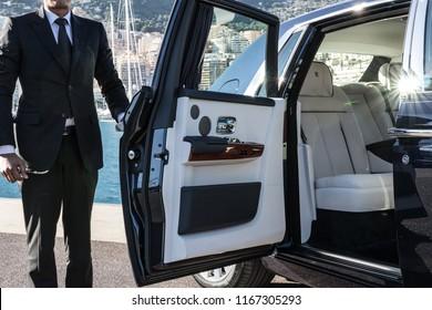 Monte - Carlo, Monaco 28 August 2018 Rolls - Royce Phantom VIII 8, Driver opens door, city at background.