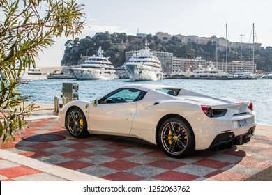 Monte Carlo, Monaco 7 December 2018, Ferrari 458 Italia Spider 2019 white, stands on parking slot with city background to yachts