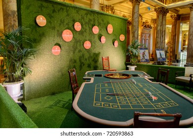 MONTE CARLO, MONACO - AUG 13, 2017: Table in the Hall of the Monte Carlo Casino, popular gambling complex opened in 1863