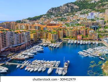MONTE CARLO, MONACO- AUGUST 17: Port and city view of Monte Carlo, Monaco on August 17, 2015. Monte Carlo, where the Monte Carlo Casino is located and the Formula 1 Monaco Grand Prix takes place.
