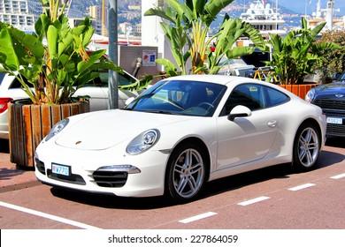 MONTE CARLO, MONACO - AUGUST 2, 2014: White sports car Porsche 991 911 Carrera at the city street.