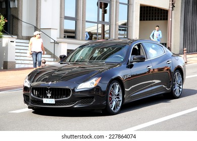 MONTE CARLO, MONACO - AUGUST 2, 2014: Black luxury sedan Maserati Quattroporte at the city street.
