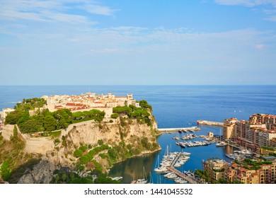 MONTE CARLO, MONACO - AUGUST 20, 2016: Monte Carlo city and harbor high angle view in a sunny summer day, blue sky in Monte Carlo, Monaco.