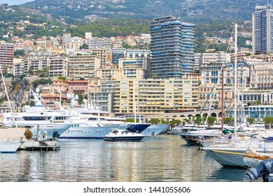 MONTE CARLO, MONACO - AUGUST 20, 2016: Monte Carlo harbor with boats and luxury yachts, city background in a summer day in Monte Carlo, Monaco.