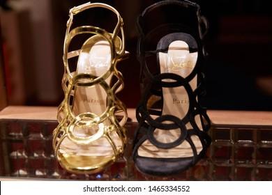 MONTE CARLO, MONACO - AUGUST 20, 2016: Christian Louboutin high heel shoes in fashion luxury store in Monte Carlo, Monaco.