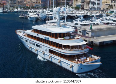 Monte Carlo, Monaco - December 08, 2009: W2 Wedge Too yacht go into sea port. Yacht club in harbor. Sea adventure and boat trips. Pleasure and sport. Vacation and summer wanderlust.