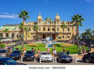 MONTE CARLO, MONACO - JULY 25: People gathering in front of the world famous Casino of Monte Carlo. Monte Carlo, Monaco on July 25, 2014