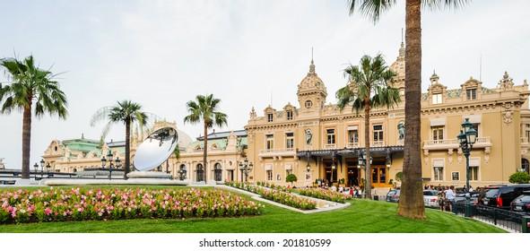 MONTE CARLO, MONACO - JUN 24, 2014:  Main entrance and the square of the Monte Carlo Casino. Monte Carlo Casino  includes a casino, the Grand Theatre de Monte Carlo. It's the main sight of Monte Carlo