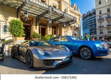 MONTE CARLO, MONACO - JUNE 15, 2016: Luxury cars next to the grand casino in Monte Carlo in Monaco on June 15, 2016