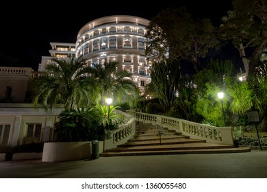 Monte Carlo, Monaco - March 29, 2019: Night view of the Hotel de Paris, is an exquisite palace hotel, situated in city centre adjacent to Casino Monte Carlo. Built in 1864 an exceptional luxury hotel