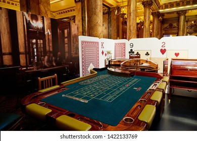 Monte Carlo, Monaco - September 17, 2016: A view of the lobby of the Casino de Monte-Carlo. Beautiful interior of the casino in Monaco with marble and gold decoration and tourists in it
