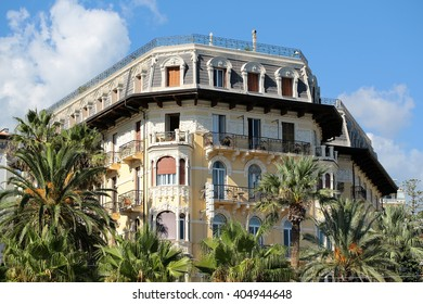 Monte Carlo, Monaco - September 21, 2015: historic palace luxury old building house among palms mediterranean architecture on blue sky background