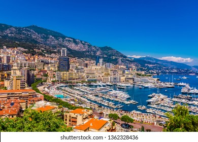 MONTE CARLO, MONACO/FRANCE - JULY 08 2016 :  Panoramic view of Monaco with great port and luxury yachts. Monaco is a popular travel destination and a wealth symbol on France Mediterranean coastline.
