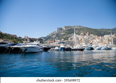 MONTE CARLO-APRIL 20: View of Monte Carlo Harbor on April 20, 2014 in Monte Carlo. Monte Carlo is situated on a prominent escarpment at the base of the Maritime Alps along the French Riviera.