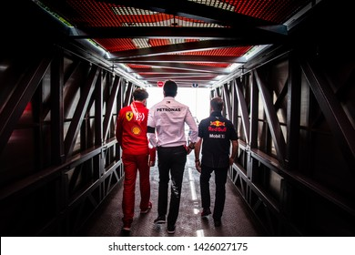 Monte Carlo/Monaco 25/05/2019 - F1's top brass - Mattia Binotto (Ferrari), Toto Wolff (Mercedes), Christian Horner (Red Bull) heading to the pits together before the start of FP3 ahead of qualifying
