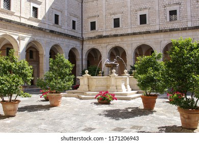 Monte Cassino, Italy  - 2017-06-26  Courtyard with fountain and greenery in the Abbey of Monte Cassino