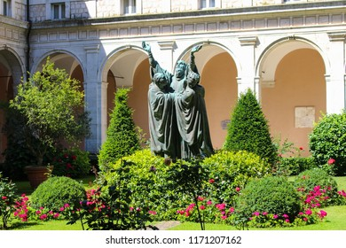 Monte Cassino, Italy  - 2017-06-26  Courtyard with statue of a saint with flowers and greenery in the Abbey of Monte Cassino