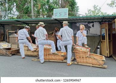 Monte (Funchal), Portugal - 17 September, 2018: The toboggan drivers with their basket cars waiting for tourists at start point for toboggan run
