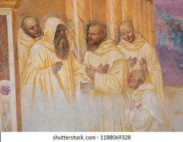 Monte Oliveto Maggiore, Italy - August 6, 2018: Fresco in the Monastry of Monte Oliveto Maggiore, near Siena, Tuscany, Italy, depicting a Scene in the Life of St Benedict