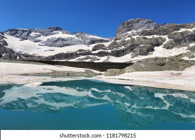 Monte Perdido Peak and Marbore cylinder from Marbore Iced lake in Ordesa national Park, Huesca, Spain