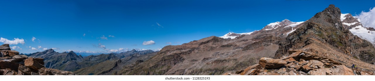 Monte Rosa Massif, Aosta Valley, Italy. Climbing to Stolemberg (3,202 m, on the right). In the background, Monte Rosa Massif.