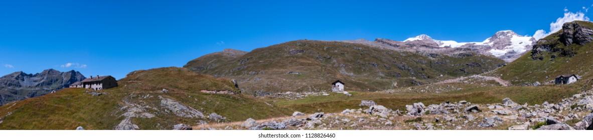 Monte Rosa Massif, Aosta Valley, Italy. Mountain huts near Lake Gabiet (Gressoney Valley). In the background, Lyskamm and Vincentpiramid.
