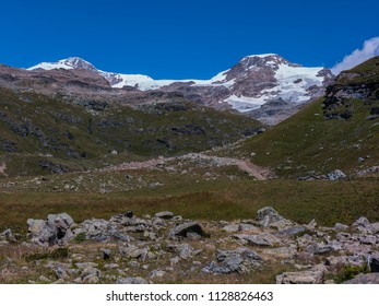 Monte Rosa Massif, Aosta Valley, Italy. Landscape with mountain huts near Lake Gabiet (Gressoney Valley). In the background, Lyskamm and Vincentpiramid.