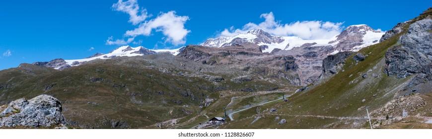Monte Rosa Massif, Aosta Valley, Italy. Landscape with alpine refuge near Lake Gabiet (Gressoney Valley). In the background, Lyskamm and Vincentpiramid.