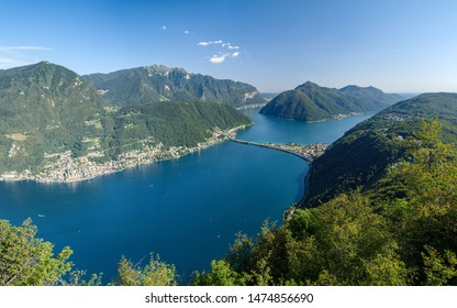 Monte San Salvatore, Lugano, Switzerland, August 03, 2019 - View on the Lugano lake, Montecampione, Melide causeway and monte San Giorgio taken from panoramic viewpoint in San Salvatore (912 m)