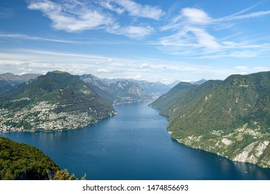 Monte San Salvatore, Lugano, Switzerland, August 03, 2019 - View on the Lugano lake, Monte Brè and Italy on the background taken from panoramic viewpoint in San Salvatore (912 m)