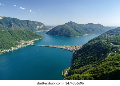 Monte San Salvatore, Lugano, Switzerland, August 03, 2019 - View on the Lugano lake, Melide causeway and monte San Giorgio taken from panoramic viewpoint in San Salvatore (912 m)
