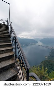 Monte San Salvatore on a cloudy and rainy day with a view to Lugano lake. The Monte San Salvatore (912 m) is a mountain in the Lepontine Alps above Lake Lugano and the city of Lugano in Switzerland.