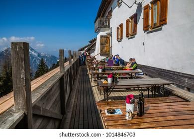 Monte Santo di Lussari, Tarvisio, Italy -  november 2017: open air cafe with majestic panoramic view of mountains in small ancient village in Monte Lussary, Tarvisio, Friuli-Venezia Giulia, Italy