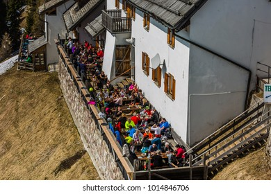Monte Santo di Lussari, Tarvisio, Italy -  november 2017: open air cafe with majestic panoramic view of mountains in small ancient village in Monte Lussary, Tarvisio, Friuli-Venezia Giulia, Italy