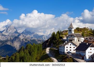 Monte Santo di Lussari - Tarvisio Italy / Village of Monte Lussari (1790 m) and the peak of Mangart (2677 m.) in the Italian Alps. Tarvisio, Friuli Venezia Giulia, Italy