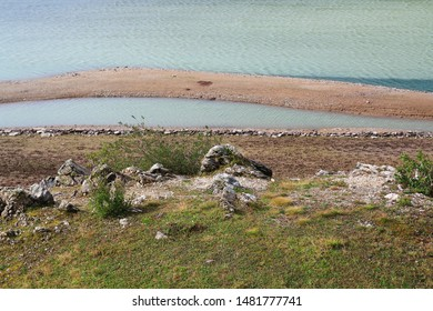 Monte Spluga reservoir, lake on the Spluegen Pass in Italy and Switzerland