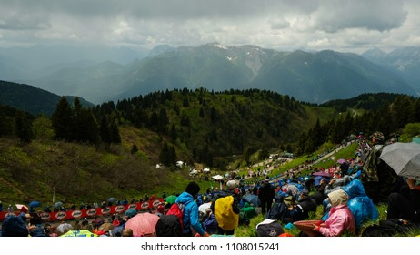Monte Zoncolan, Italy - April 22, 2018: Fans watching the Giro d'Italia bicycle race from the side of the road on top of Monte Zoncolan in the Dolomite Mountains, Italy