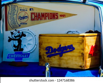 Montebello, California / USA - July 15, 2017: Trunk of a classic Chevrolet collector car, filled Los Angeles Dodgers 1981 World Series pennant, Felix Chevrolet  logo and Jackie Robinson tribute