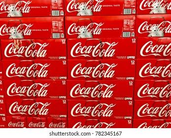 MONTEBELLO/CALIFORNIA - NOV. 25, 2017: Cases of Coca Cola stacked on supermarket flooring. Montebello, California USA