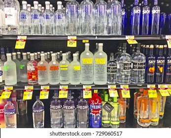 MONTEBELLO/CALIFORNIA - SEPT. 9, 2017: Rows of bottled alcoholic beverages stacked on shelves in a local supermarket. Montebello, California USA