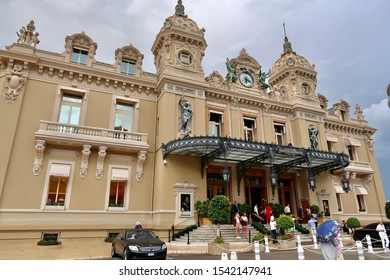 Monte-Carlo, Monaco / Monaco - 09 06 2019: The Grand Monte-Carlo Casino, gambling and entertainment building in Monaco with palm trees and dark sky